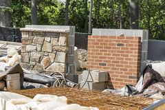 Sample brick and stone walls on a construction site Royalty Free Stock Image