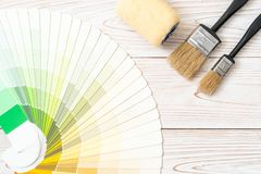 Sample colors catalogue pantone or colour swatches book. With paint roller brush stock photography