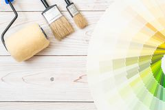 Sample colors catalogue pantone or colour swatches book. With paint roller brush royalty free stock photo