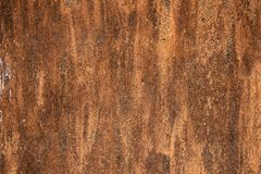 Sample of worn by time fiberboard with shabby, dirty, and cracked paint and relief texture. Grunge background in brown stock photos