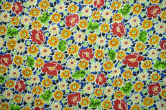 A sample of the fabric: floral patterns and multi-color. The sample of cotton fabric: bright multy colors and floral patterns. Lightweight, absorbent fabric for Royalty Free Stock Photo