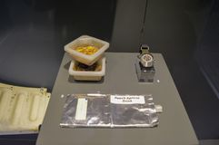 A sample of food astronauts eat while they are in space with apricot drink and a space watch stock images