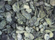 A sample of gravel from travertine and marble, used in landscape design to create a garden of stones Stock Photos