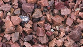 A sample of gravel from travertine and marble, used in landscape design to create a garden of stones Royalty Free Stock Photos