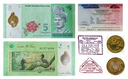 Malaysia money and visa stamp. The sample of malaysia money note and coin and visa stamp Stock Photo