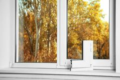 Sample of modern window profile on sill indoors. Space for text. Installation service royalty free stock image