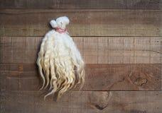 Sample of natural wavy sheep fleece fiber mounted on board Stock Photo