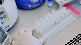 Sample preparation - extraction of DNA from blood samples in a laminar cabinet. stock footage