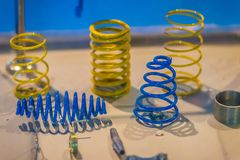 Sample product of blue and yellow metal helical coil springs. Sample product of blue and yellow metal helical coil springs business stock photography