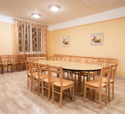 Sample room. With table and chairs. Pictures at wall the same photo royalty free stock images