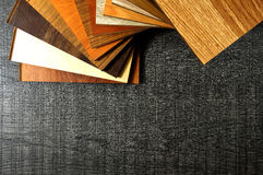Sample studio photo of laminate flooring. Repair, building and h. Laminate wood texture floor and Stair Edging. Samples of laminate and vinyl floor tile Royalty Free Stock Photo