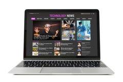 Sample technology news website on laptop. stock image
