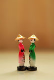 Vietnamese woman dolls. Sample of Vietnamese women with traditional hat Royalty Free Stock Photo
