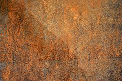 Sample of worn by time fiberboard with shabby, dirty, and cracked paint and relief texture. Grunge background in brown royalty free stock photography