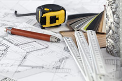 Samples of architectural materials. Color samples of architectural materials - plastics, metric folding ruler, tape measure, pencil & architectural drawings of royalty free stock photos