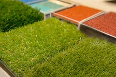 Samples of an artificial lawn in a trade exposition royalty free stock image