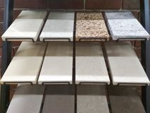 Samples of artificial stone. On a metal exhibition stock photography