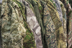 Samples camouflage military clothes. In the store Stock Photography