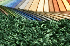 Samples of collection linoleum on carpet backgr Stock Photos