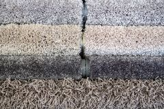 Samples of color of a carpet, gray rolls stock photos