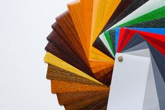Samples of the colored lamination. The color palette on the table stock images