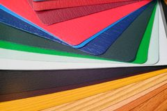 Samples of the colored lamination. The color palette on the table stock image