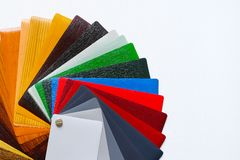 Samples of the colored lamination. The color palette on the table stock photo