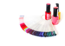Samples of colored nail polish on a white table. Nail salon Royalty Free Stock Photography