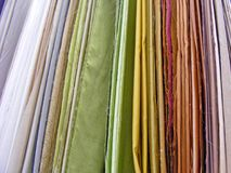 Samples of colorful fabric in shop / Different Multi colored fabrics. Samples of colorful fabric in shop Stock Photos