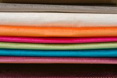 Samples of colorful interior fabrics. Book of fabrics for curtains, upholstery royalty free stock images