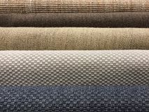 Samples of different brown woven carpet texture from sisal, blue royalty free stock photos