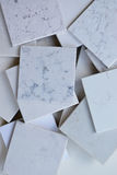 Samples of different stones mainly white based with marble like grains and veins Royalty Free Stock Photos