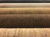 Samples of different woven carpet texture from sisal and natural. Samples of brown woven sisal and natural fiber carpet roll for texture and background Royalty Free Stock Image