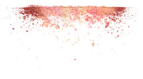 Samples of dry blush, powder, bronzers and highlighter scattered in a line isolated on a white background. Samples of dry blush, powder, bronzers and highlighter royalty free stock photo