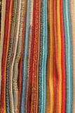 Samples of fabric. Multy colored samples of fabric to serve as background Royalty Free Stock Photo