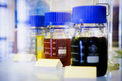 Samples of Fuels in Closable Bottle. Yellow, red and black liquid in bottle Royalty Free Stock Images