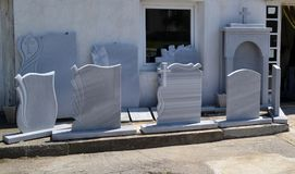 Samples of gravestones are along the sidewalk royalty free stock images