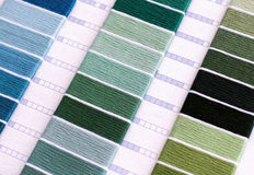 Samples of green and blue cotton thread. Close-up Royalty Free Stock Photo