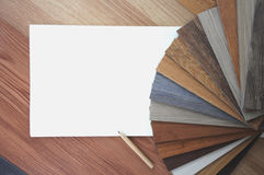 Samples of laminate and vinyl floor tile on wooden Background.A. A studio photo of laminate flooring accessories. Repair, building and home concept. Interior and Stock Photo
