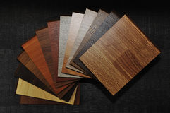 Samples of laminate and vinyl floor tile on wooden Background.wo. LA studio photo of timber laminate flooring Stock Images