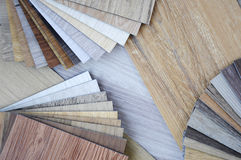 Samples of laminate and vinyl and veneer texture on wooden Backg Stock Photography