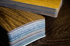 Samples of linoleum. Cutting and laying of floor coverings. Samples of linoleum. Cutting and laying of flooring. Laminate, parquet, vinyl tile Stock Image