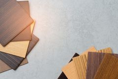 Samples of material, wood , on concrete table.Interior design select material for idea.  royalty free stock image