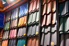 Samples of metal tiles roof in building store. Samples of metal tiles roof in the building store Stock Image