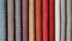 Samples of multi-colored fabrics for curtains close-up royalty free stock photos