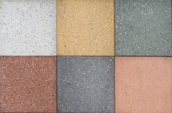 Samples of outdoor floor tiles of different colors. Artificial stone. stock image