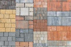 Samples of rectangular pavement tiles. Urban background. Samples of rectangular pavement tiles of black, orange, yellow, red, gray Royalty Free Stock Photo