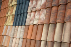 Samples of roof tiles on the roof in the exhibition hall. Industry Royalty Free Stock Photography