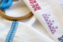 Samples Ukrainian embroidery, unfinished work in progress and tools for embroidery Royalty Free Stock Photo
