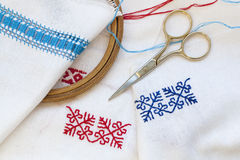 Samples Ukrainian embroidery, unfinished work in progress and tools for embroidery Stock Photography